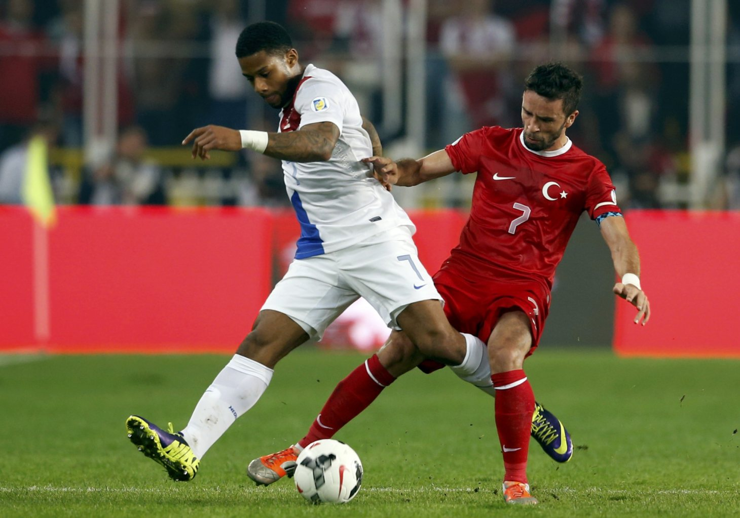 Netherlands' Lens challenges Turkey's Gonul during 2014 World Cup qualifying soccer match in Istanbul