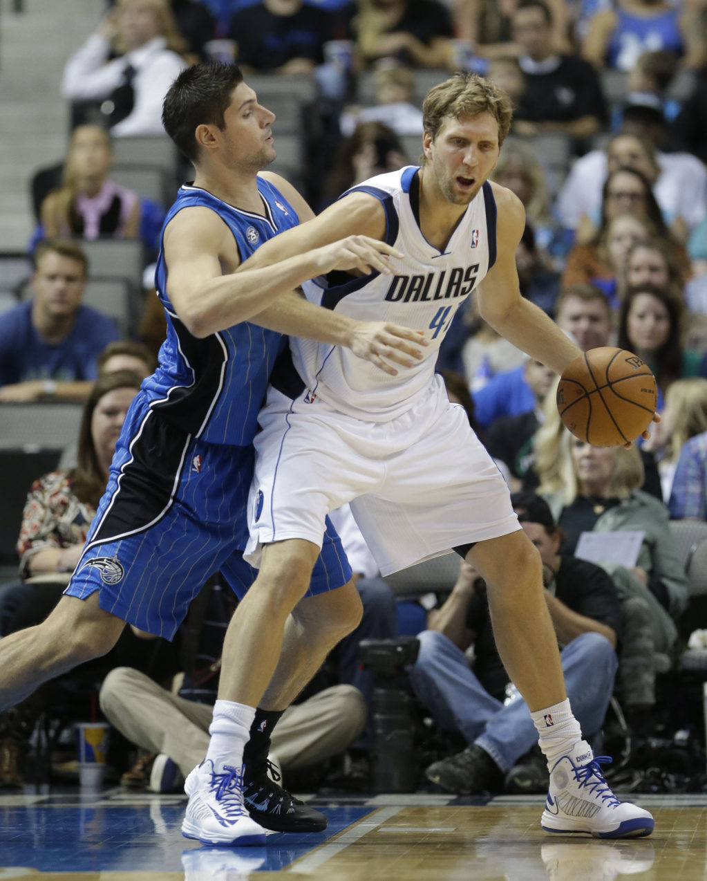 Dallas Mavericks power forward Dirk Nowitzki (41) of Germany dribbles against Orlando Magic center Nikola Vucevic (9) of Montenegro during the first half...