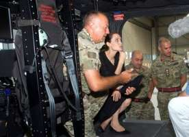 U.S. actress and UNHCR Special Envoy Angelina Jolie sits in a rescue helicopter during a visit to the Armed Forces of Malta Air Wing outside Valletta